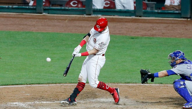 Cincinnati Reds right fielder Jesse Winker (33) hits his first career grand slam in the sixth inning of the MLB National League game between the Cincinnati Reds and the Chicago Cubs at Great American Ball Park in downtown Cincinnati on Thursday, June 21, 2018. The Reds won the first game of the series, 6-2.