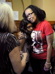 Family and friends of murder victim Jordan Rogers, including his sister, Sharie Ross, center, gather Wednesday after Ricard Taylor was sentenced to life in prison without parole.