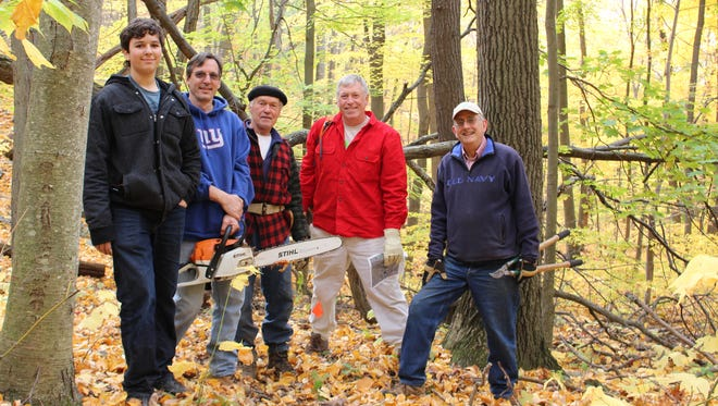 Volunteers for the Hudson Highlands Land Trust and the Putnam Highlands Audubon Society work on a new trail on the Watergrass Sanctuary this fall. More than 19 acres were added to the sanctuary this summer thanks to a partnership with the land trust, the Audubon Society, Scenic Hudson, the Open Space Institute and a private landowner.