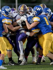 A gang of Wooster defenders tries to take down Lexington
