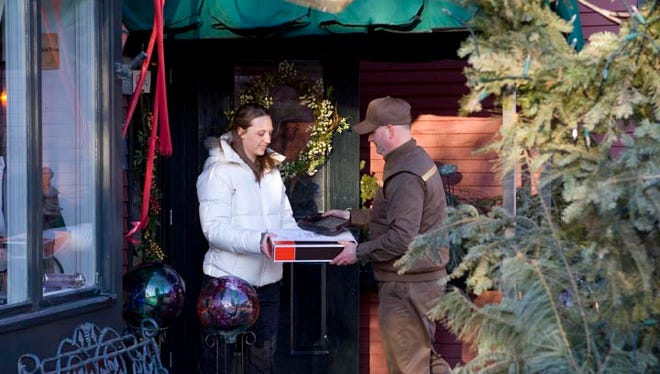 Parcel carriers are working around the clock to deliver millions of packages by Christmas