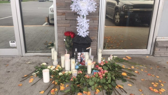 A memorial has been set up out front of the Gates Pub after a deadly shooting Saturday.