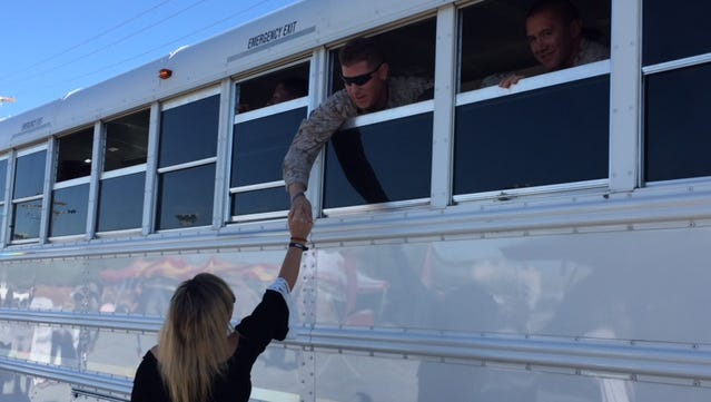 Marines and sailors from 1st Battalion, 7th Marines based at Marine Corps Air Ground Combat Center, Twentynine Palms, bid farewell to friends and family on Oct. 9, 2015. The servicemen are deploying overseas.