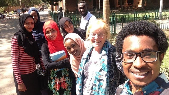 Ellen Gruenbaum, second from right, poses with students at University of Khartoum in Sudan. Gruenbaum, an anthropology professor at Purdue University, is in Sudan on a research project. Sudan is one of seven nations targeted by President Donald Trump's executive order barring entry into the United States for 90 days.