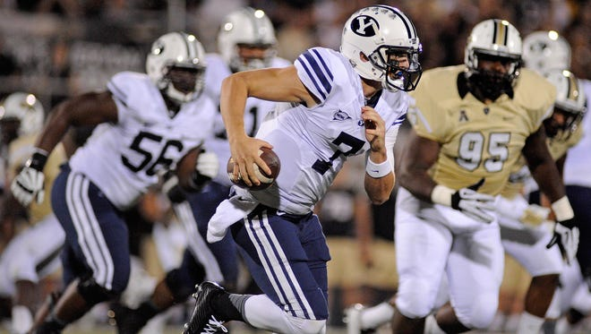 BYU quarterback Christian Stewart (7) scrambles in the first half against UCF at Bright House Networks Stadium in Orlando, Fla., on Oct. 9. Stewart is expected to start Saturday against Nevada, replacing the injured Taysom Hill.