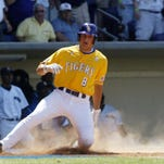 LSU's Mikie Mahtook slides safely across home plate against Southern University in 2009. Mahtook's foundation has awarded a $5,000 grant to assist in flood relief.