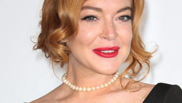 Lindsay Lohan arrives at the amfAR Gala Cannes 2017