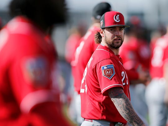 Cincinnati Reds starting pitcher Brandon Finnegan (29) warms up before practice at the Cincinnati Reds training complex in Goodyear, Ariz., on Monday, Feb. 19, 2018.