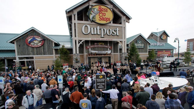 People wait for the grand opening of the Bass Pro Shops Outpost store in Atlantic City, N.J. in April 2015.
