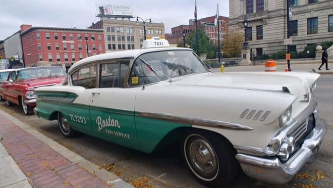 "A vintage Boston Taxi Cab parked on Main Street on Friday is one of the classic cars being used in ""Julia,"" an HBO Max series being filmed in Worcester about the life of Julia Child."