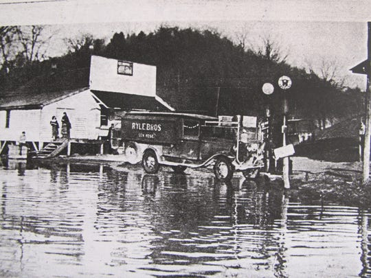 1937: A truck takes stock from the Rabbit Hash General Store to save it from rising waters during the 1937 flood.