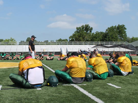Members of the Parkview football team stretch.