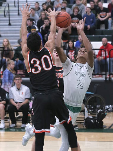 Madison's Kyle Jackson shoots for the basket in front