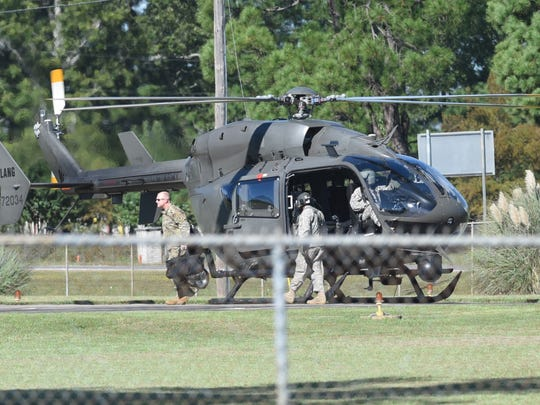 Col. Ed Bush of the Louisiana National Guard exits a helicopter after it brought him to Camp Minden following an early morning explosion.