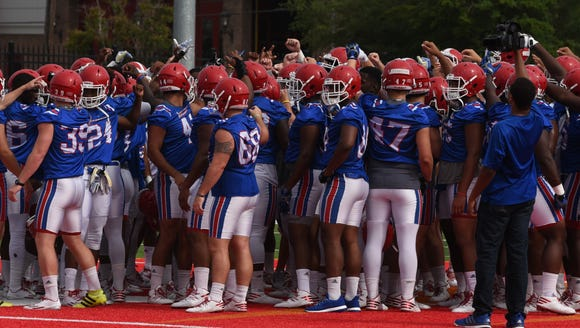 The LA Tech Bulldogs huddle up at the start of their