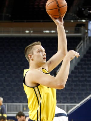 Michigan's Mark Donnal puts up a shot during practice Oct. 2, 2015, in Ann Arbor.