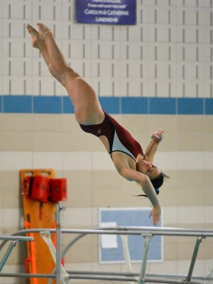 Sami Nickerson of Homestead competes in the diving competition at the Nicolet Invitational girls swim meet Saturday at Nicolet.