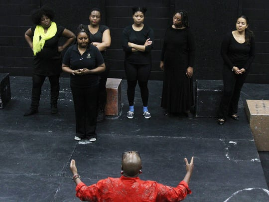 "Director Patricia Idlette works with actors in a scene from ""For Colored Girls Who Have Considered Suicide When the Rainbow Is Enuf"" at the Black Box Theater at Florida SouthWestern State College on Tuesday night."