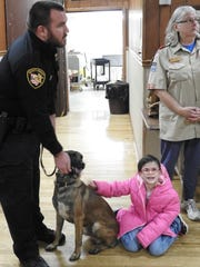 Deputy Steve Mox with K-9 officer Chili, Mikayla Girard and Cathy Waibel at a recent meeting of Boy Scout Troop 403.