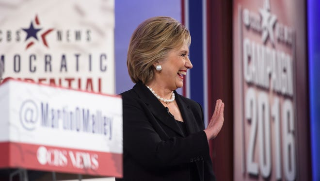 Former Secretary of State Hillary Clinton waves to the crowd as she walks on to the stage for the Democratic presidential debate at Drake University on Saturday, Nov. 14, 2015.