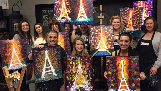Students display finished paintings inspired by the theme, Paris in Color, during an art class at Uptown Art in Denville on Jan. 3.