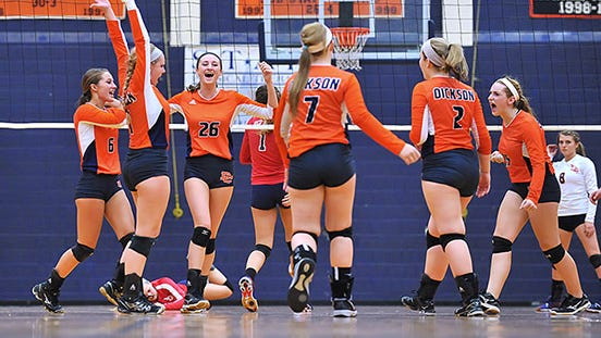 Dickson County celebrates after knocking off Creek Wood in high school volleyball action last night. Both teams are home tonight in district action.