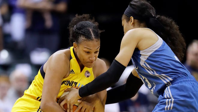Indiana Fever's Marissa Coleman is defended by Minnesota Lynx's Maya Moore during the first half of a WNBA basketball game Wednesday, Aug. 30, 2017, in Indianapolis. (AP Photo/Darron Cummings)