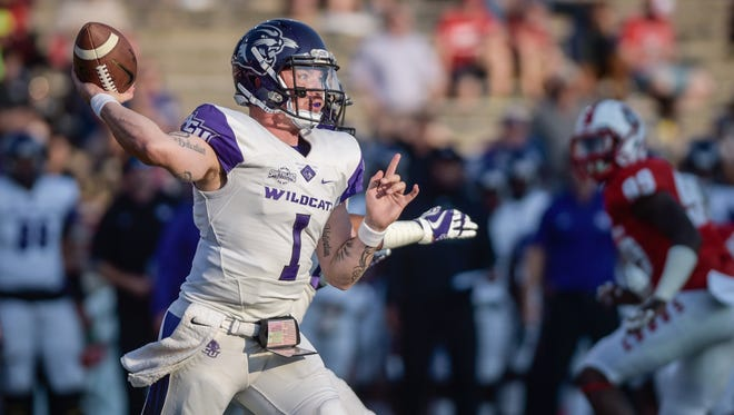 Abilene Christian quarterback Dallas Sealey looks for an open receiver during a loss last Saturday at New Mexico. The Wildcats, an FCS program, will play their second straight game against an FBS opponent this Saturday at CSU.