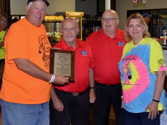 Gumby's Club Fore a Cure founders Rob and Denise Roseff were recently honored by the Clipper City Chordsmen with a Harmony Award. Picutred, from left: Rob Roseff, Ron Krupsky, David Rabe, and Denise Roseff.