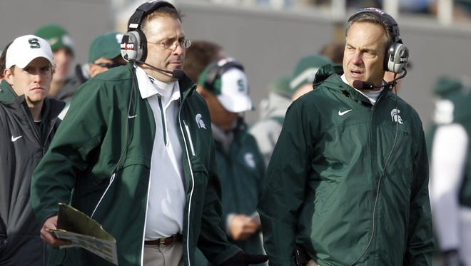 Michigan State defensive coordinator Pat Narduzzi, left, and coach Mark Dantonio talk during a game Nov. 6, 2011, in East Lansing.