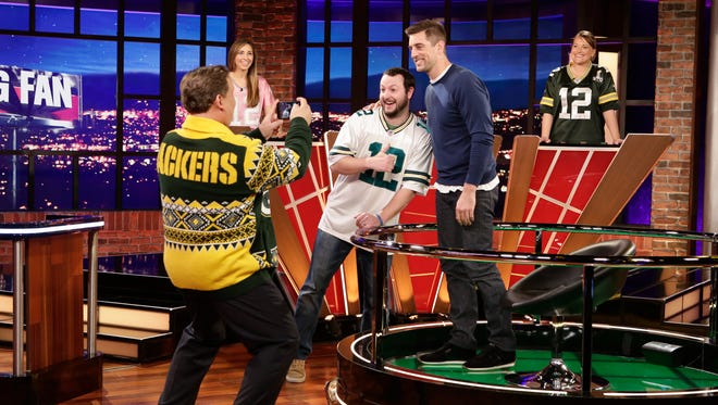 "Three lucky Green Bay Packers super fans were chosen to show how much they know about Aaron Rodgers during his episode of the new ABC game show ""Big Fan,"" which airs at 9:30 p.m. Monday. That's host Andy Richter in the Packers sweater."