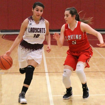Tularosa's Bethany Betancur, left. brings the ball