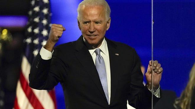President-elect Joe Biden gestures to supporters Saturday, Nov. 7, 2020, in Wilmington, Del.