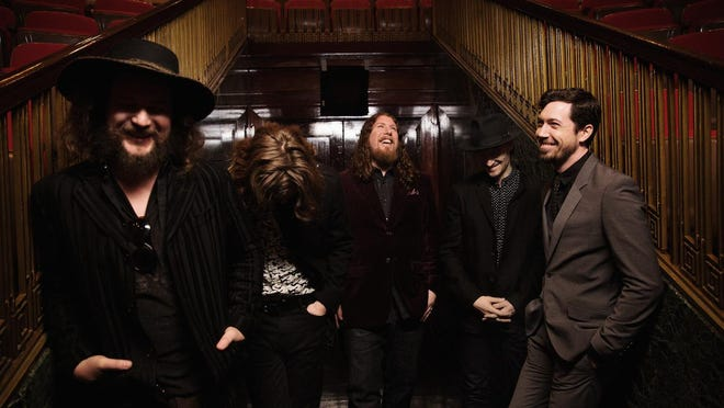 """My Morning Jacket's new album, """"The Waterfall,"""" was released Monday. The band is, left to right, Jim James, Carl Broemel, Patrick Hallahan, Bo Koster and Tom Blankenship."""