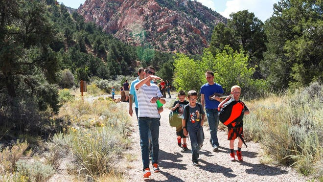 SUU students lead their groups East Elementary children along Coal Creek after setting out their animal track traps.