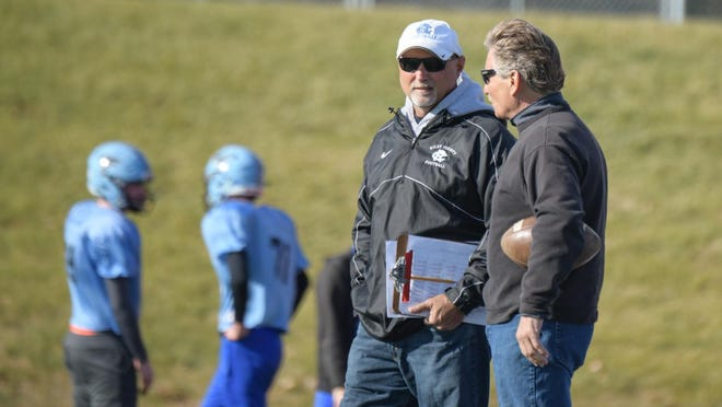 Riley County football coach Steve Wagner, left, talks to his brother, Dan, during practice in preparation for the 2018 Class 2A state championship game. Wagner, who announced his retirement on Monday, led the Falcons to three state championship games in his 37-career, compiling a 268-126 record overall.
