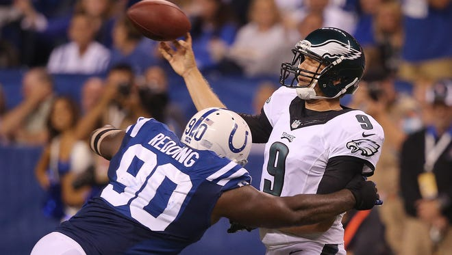 Colt defensive end Cory Redding gets to Eagle quarterback Nick Foles in the third quarter but not before he lets go with a pass. Indianapolis hosted Philadelphia for Monday Night Football on Monday, September 15, 2014 at Lucas Oil Stadium.