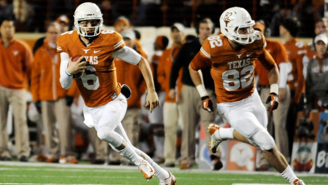 Texas Longhorns quarterback Case McCoy scrambles with help from tight end Geoff Swain against the Texas Tech Red Raiders at Darrell K Royal-Texas Memorial Stadium.