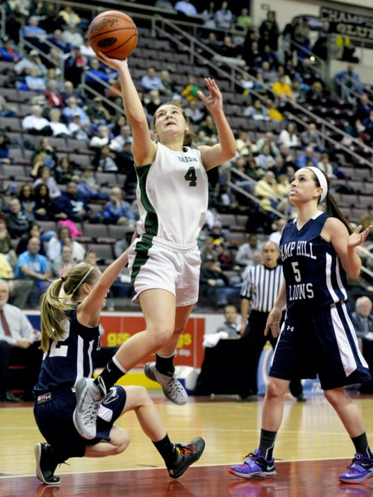 York Catholic's Anne Lehr goes up for a shot against Camp Hill during the first half of the District 3 Class AA basketball championship game Thursday at Hershey's Giant Center. The Fighting Irish won their 10th straight title with a 63-57, overtime victory.