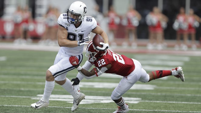 Connecticut tight end Jay Rose (91) is tackled by Indiana defensive back Jamar Johnson (22) during the Huskies' 38-3 loss a year ago in Bloomington, Ind.