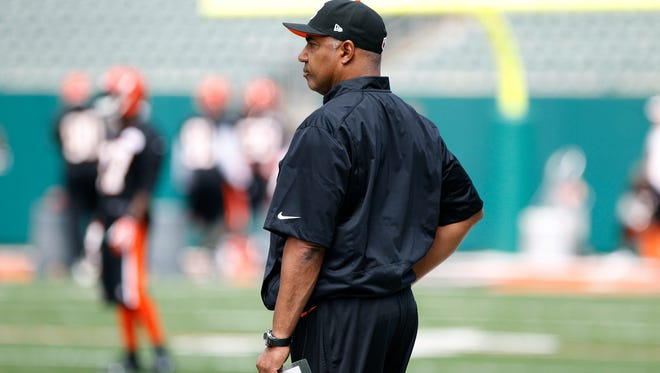 Bengals head coach Marvin Lewis watches his team June 3 during organized team activities (OTAs) at Paul Brown Stadium.