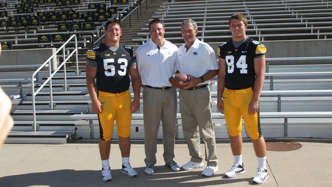 Iowa coach Kirk Ferentz, second from right, and sons James, Brian and Steven are shown in a 2012 photo.