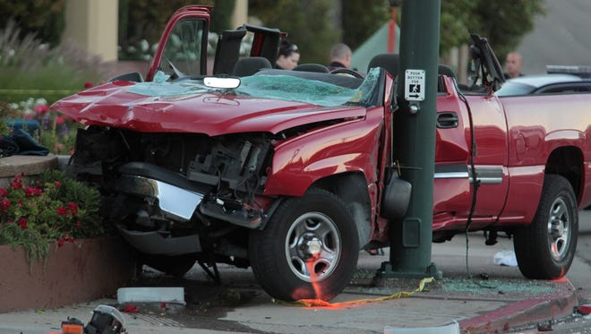 Police investigate the scene of a fatal accident on North Main Street and Parkside Drive near the Walnut Creek Marriott in Walnut Creek, Calif. on Saturday, Sept. 8, 2012.