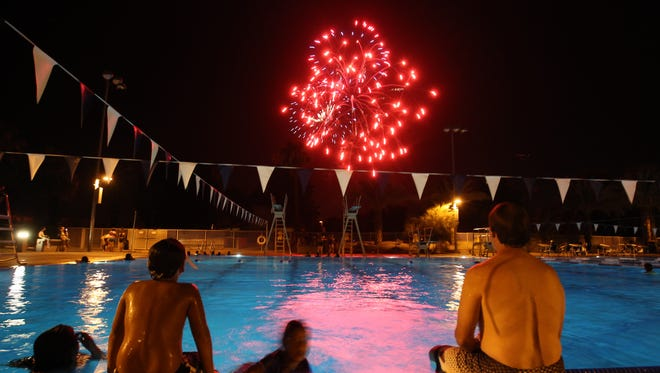 Crowds view Independence Day fireworks at the Palm Desert Aquatic Center on Thursday, July 4, 2013.