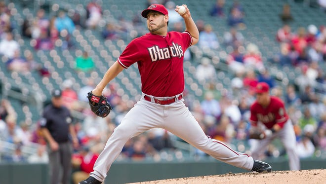Sep 24, 2014: Arizona Diamondbacks starting pitcher Vidal Nuno (54) pitches in the first inning against the Minnesota Twins at Target Field.