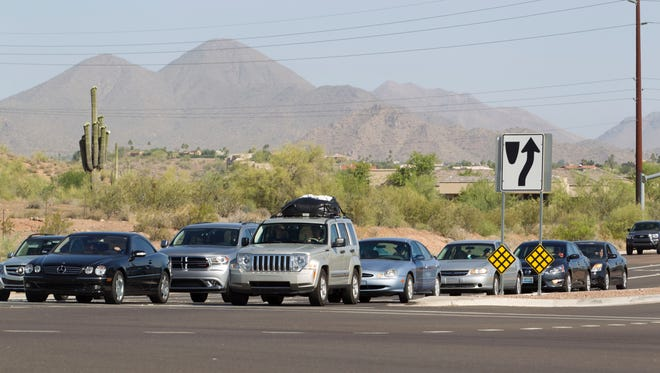 Traffic on Shea and the Beeline Highway intersection going towards to Saguaro Lake, Four Peaks and up north to Payson on Wednesday May 21, 2014.