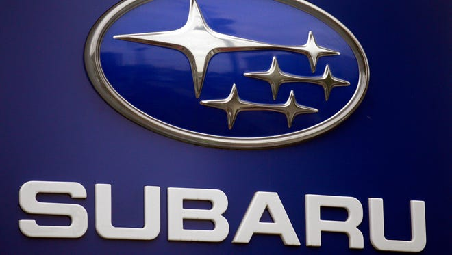 FILE - In this Aug. 31, 2011, file photo, a Subaru logo is displayed on a sign at a dealer's lot, in Portland, Ore. Subaru is recalling more than 660,000 cars and SUVs because the brake lines can rust and leak fluid, and that can cause longer stopping distances. For about half the vehicles, it?s the second recall for the same problem. (AP Photo/Rick Bowmer, File)