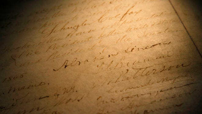 The signature of President Abraham Lincoln on a rare, restored copy of the 13th Amendment.
