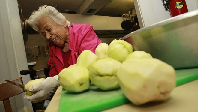 Chef Leah Chase, known as the Queen of Creole Cuisine, peels mirlitons at her restaurant Dooky Chase in New Orleans. Dooky Chase restaurant was known as a gathering place during the 1960s among many who participated in the civil rights movement and was known as a gallery due to its extensive African-American art collection.