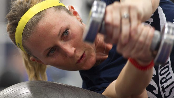 In a file photo from October 2013, former Tennessee swimmer Nicole Gross, who was severely injured in the Boston Marathon bombing, works out during physical therapy.